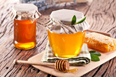 Glass cans full of honey. Royalty Free Stock Photo