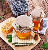 Glass cans full of honey. Stock Image