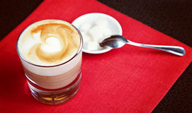 Glass of capuccino with sugar Stock Image