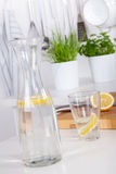 Glass and carafe with lemonade on a kitchen counter Royalty Free Stock Image