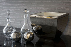 Glass carafe and silver bowl Stock Photos