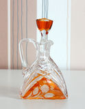 Glass carafe on striped background. Royalty Free Stock Images