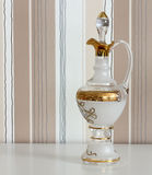 Glass carafe on striped background Royalty Free Stock Photos