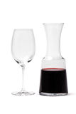 Glass And Carafe With Wine. Carafe with red wine and empty glass isolated on white Royalty Free Stock Photography