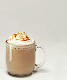 Glass of caramel mocha. A glass of hot mocha with caramel and whipped cream Royalty Free Stock Image