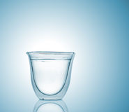 Glass with carbonated water on blue gradient background Stock Image