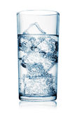 Glass of carbonated water with ice Royalty Free Stock Photo
