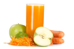 Glass with carrot juice. On white Stock Photos