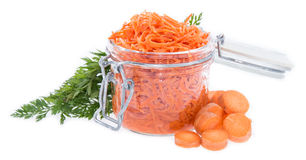 Glass with Carrot Salad isolated on white Royalty Free Stock Photos