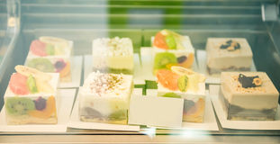 Glass case with desserts Stock Photography