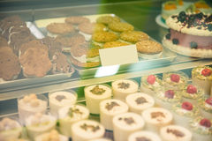 Glass case with desserts Stock Images