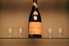 Glass case with expensive wine, displayed in specialty shop, Paris, France, 2016 Royalty Free Stock Photos