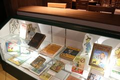 Glass case filled with books covering beloved stories of Wizard of Oz, Oz Museum, Chittenango, New York, 2018