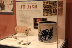 Glass case with pottery excavated from site,State Museum,Albany,2016 Royalty Free Stock Images