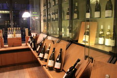 Glass cases of expensive wines, displayed in specialty shop, Paris, France, 2016 Royalty Free Stock Images