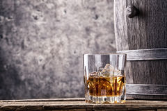 Glass and cask with old whiskey Stock Images