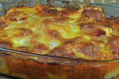 Glass casserole with baked cheese Stock Photo