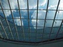 Glass ceiling. And cloudy blue sky Stock Photo