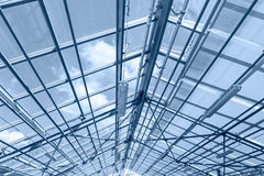 Glass ceiling of contemporary greenhouse. steel roof trusses det Stock Photos