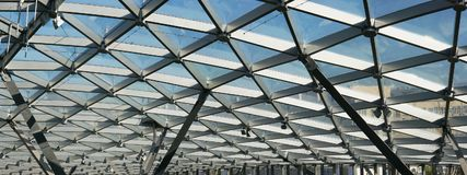 The glass ceiling of the modern building supports a steel beams Royalty Free Stock Photo