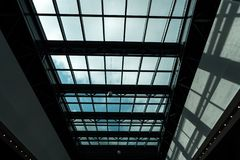 Glass ceiling in a shopping mall with a bright sun outside stock photography
