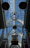 Glass Ceiling in a shopping mall in Victoria with hanging giant. Glass Ceiling in a shopping mall in Victoria, British Columbia, with hanging giant wall clock stock photography