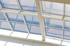 Glass ceiling with window. Square shot, vintage. closeup. The shopping center, business center, royalty free stock photography