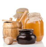 Glass, ceramic and wooden jars full of honey Stock Photos
