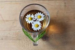 Glass of chamomile tea Royalty Free Stock Image