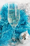 Glass with champagne. Ornaments and a toy on a fur-tree royalty free stock photography