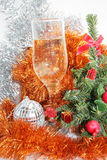 Glass with champagne. Ornaments and a toy on a fur-tree stock images