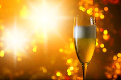 Glass of champagne on a background of Christmas  decoration Stock Images