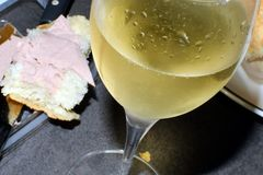 Glass of champagne and baguette with foie gras. Stock Photo