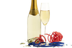 Glass of champagne with blow-outs and confetti in Royalty Free Stock Photo
