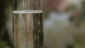 A glass of champagne on a blurred background. Celebration concept