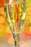 Glass of champagne on bokeh background Stock Image