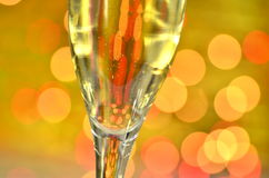 Glass of champagne on bokeh background Royalty Free Stock Photo