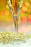 Glass of champagne on bokeh background Royalty Free Stock Image