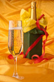 Glass of champagne and bottle Royalty Free Stock Photography
