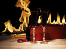 Glass of champagne and bottle in box . wooden table royalty free stock images