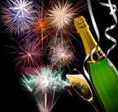 Glass of champagne with bottle with fireworks Stock Image