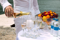 A glass of champagne for the bride and the groom Royalty Free Stock Images