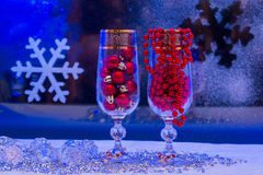 Glass of champagne, Christmas decorations Stock Photos