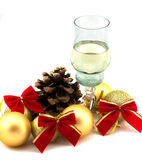 Glass of champagne with Christmas decorations on a white background Royalty Free Stock Image