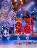 A glass of champagne, Christmas tree, Christmas decorations. bac. Glasses of champagne, Christmas tree, Christmas decorations on a background of a winter window Stock Images