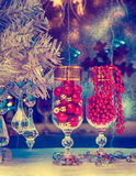 A glass of champagne, Christmas tree, Christmas decorations. bac Royalty Free Stock Photos