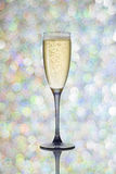 A glass of champagne on festive background Stock Images