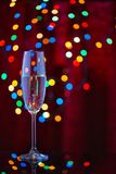 A glass of champagne on a festive background Stock Photos