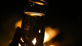 Glass of champagne. With flame on background in nature stock video footage