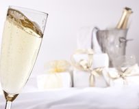 Glass of champagne and gifts Stock Photography